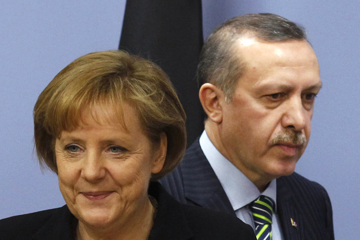 German Chancellor Merkel and Turkey's PM Erdogan arrive for a news conference in Ankara