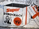 athens graffiti super democracy as seen on tv