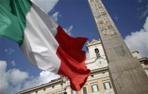 An Italian flag waves in front of the Montecitorio palace before the start of a finances vote in downtown Rome