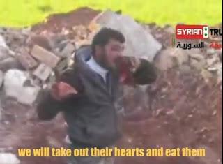 syria_rebel_eating_heart_2_1368528897_540x540.jpg