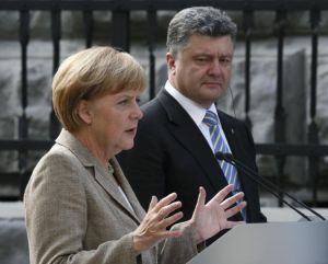 671658-germany-s-chancellor-merkel-gestures-during-a-news-conference-with-ukraine-s-president-poroshenko-in
