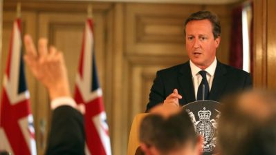 Britain's Prime Minister David Cameron answers questions at a news conference in Downing Street, central London
