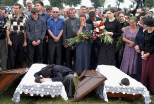 Fatima Tetova, mother of killed hostages Irina,13 and Alina,12, cry during their funeral in the town..
