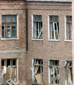 Broken windows are seen at the rear of a school building seized by heavily armed masked men and ...