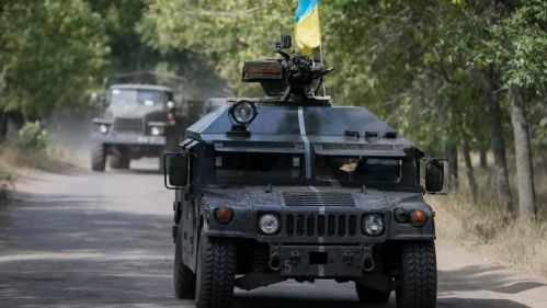 Ukrainian servicemen ride in an armoured vehicle in Kramatorsk