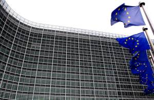 European Union flags are seen outside the European Commission headquarters in Brussels