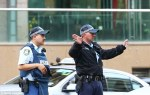Armed police storm government building on Sydney's Oxford Street and evacuate workers following threats 2