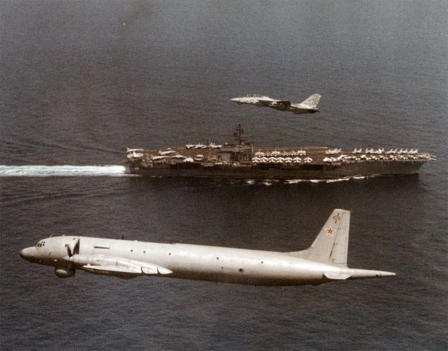 may-1996-an-f-14-tomcat-escorts-a-russian-spy-plane-as-it-passes-over-the-carrier-constellation-cv-641