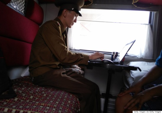 TUMANGANG, NORTH KOREA - AUGUST 19: A Customs officer is seen on the train No.100 from Moscow to Pyongyang at Tumangang railway station on August 19, 2015 in Tumangang, North Korea. North and South Korea today came to an agreement to ease tensions following an exchange of artillery fire at the demilitarized border last week. (Photo by Xiaolu Chu/Getty Images)