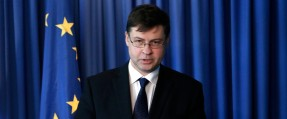 European Commissioner for Euro and Social Dialogue Valdis Dombrovskis speaks to the media during a press conference after a meeting with Cypriot Financial minister Charis Georgiades, at the foreign ministry house in capital Nicosia, Cyprus, Thursday, March 3, 2016. Dombrovskis lauded bailed-out Cyprus' commitment to implementing structural reforms for turning the economy around and putting the Eurozone member back on a growth trajectory after nearly going bankrupt three years ago. (AP Photo/Petros Karadjias)