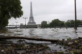 View of the flooded river-side of the River Seine near the Eiffel tower in Paris, France, after days of almost non-stop rain caused flooding in the country, June 3, 2016. REUTERS/Philippe Wojazer