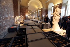 Crates containing pieces of artworks from the collections of the Louvre Museum are seen near statues after the museum was closed to the public due to the rising Seine River in Paris, France, after days of almost non-stop rain caused flooding in the country, June 3, 2016. REUTERS/John Schults