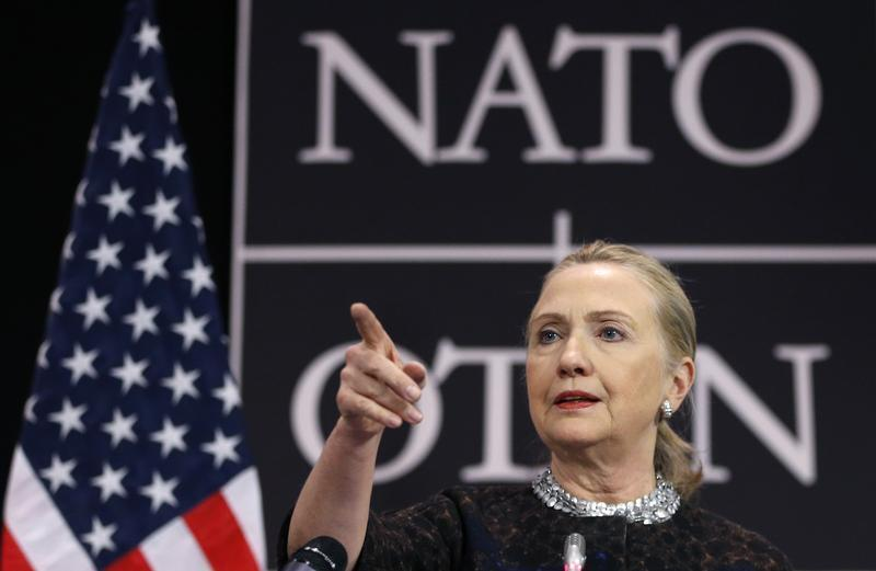 U.S. Secretary of State Clinton addresses a news conference during a NATO foreign ministers meeting in Brussels