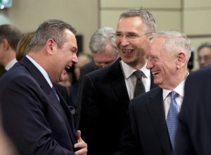 U.S. Secretary of Defense Jim Mattis, right, and NATO Secretary General Jens Stoltenb tour with a twist. He is expected to tell allies the U.S. is committed to NATO and is also hoping to secure bigger defense spending commitments. (AP Photo/Virginia Mayo)