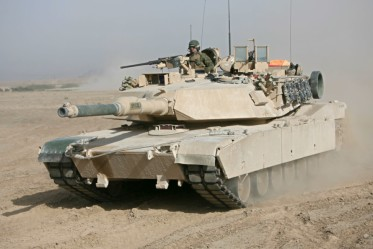 An M-1A1 Main Battle Tank rolls out across the desert near Dra Digla, Iraq, north of Fallujah, Iraq. Tankers with Company D, 2nd Tank Battalion, Regimental Combat Team 5, said that tankers are a breed apart who maintain a love-hate relationship with the 70-ton tracked vehicle that is the core of their identity.