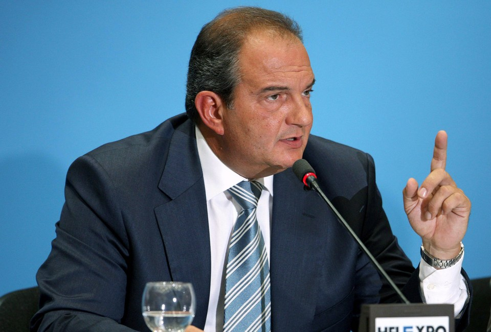 Greek Prime Minister Karamanlis answers a question during a news conference in Thessaloniki