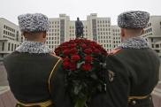 Belarusian honor guard soldiers stand as they prepare to lay flowers to the monument to Vladimir Lenin, Soviet founder during the celebration of the 100th anniversary of the 1917 Bolshev