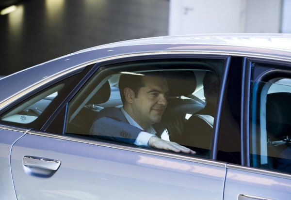 Greek Prime Minister Alexis Tsipras leaves the European Commission headquarters after a meeting with the European Commission, the International Monetary Fund the European Central Bank and the bloc's rescue fund in Brussels