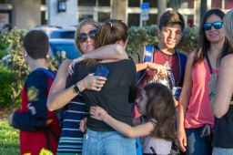 epa06525838 Students are comforted by parents and family after a shooting at Marjory Stoneman Douglas High School in Parkland, Florida, USA, 14 February 2018. Multiple fatalities have been reported and several more injured at a high school northwest of Miami. According to law enforcement the suspect is in custody. Some media are reporting the suspect as former student, Nicolas Cruz. EPA/GIORGIO VIERA