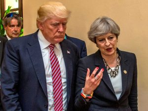 U.S President Donald Trump walks with British Prime Minister Theresa May at the G7 summit in Taormina