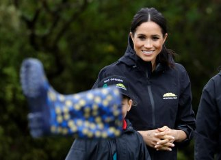 Meghan, Duchess of Sussex reacts as she watches a 'gumboot-throwing' contest following a ceremony to dedicate a 20-hectare area of native bush to the Queen's Commonwealth Canopy in Auckland, New Zealand, Tuesday, Oct. 30, 2018. Prince Harry and his wife Meghan are on day 15 of their 16-day tour of Australia and the South Pacific. (AP Photo/Kirsty Wigglesworth)