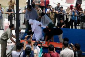 epa07852721 An Acehnese woman collapses after being caned in public for having sex outside of marraige in Banda Aceh, Aceh, Indonesia, 19 September 2019. Aceh is the only province in Indonesia that has implemented Sharia law and considers lesbian, gay, bisexual relationships and sex outside of marriage as Sharia law violations. EPA/HOTLI SIMANJUNTAK